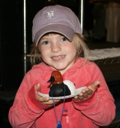 Small girl holding wooden carving