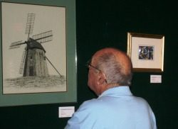 Man looking at artwork of lighthouse