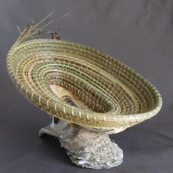 Woven green basket on rock