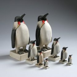Collection of wooden carved penguin sculptures