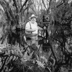 Man taking photo in nature black and white