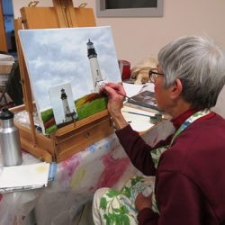 Women painting lighthouse
